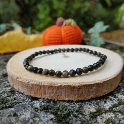 Bracelet facetté obsidienne dorée.